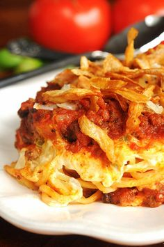 Baked spaghetti casserole layered with cream cheese and topped with onion rings--by Salad in a Jar