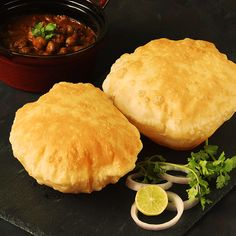 Bhatura Bhatura is a deep fried puffed bread made with flour, salt and a leavening agent. This recipe will teach you to make the best bhaturas at home. Puri Recipes, Pakora Recipes, Paratha Recipes, Bhatura Recipe, Chaat Recipe, Roti Recipe, Indian Dessert Recipes, Indian Snacks, Gastronomia