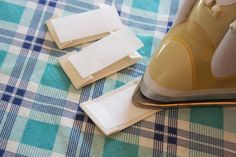 craftyblossom: fabric labels :: a tutorial - Heat & Bond method to attach labels