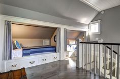 Cottage home with attic boys' room boasting gray walls and plank ceiling over side-by side ...