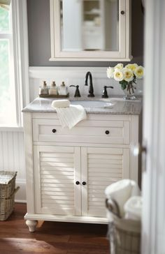 Small bath? No problem. A single vanity like this one is the answer. Loving its shutter doors and beautiful granite top. HomeDecorators.com #dreamoasis