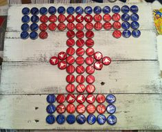 "Rangers Texas ""T"" Sign. Beer bottle caps, tacky glue, wood piece backing - design your own logo, glue the caps and add a polyurethane coating to the final product! Also use barbed wire to hang if you like the rustic look."