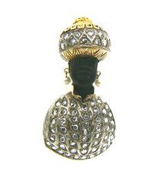 SAFEDINO Gold and Silver Blackamoor epoca 1984 diamond rose 1,75 kt  head in ebony   Giorgio Berto Design http://www.veneziagioielli.com/scheda.php?id=19