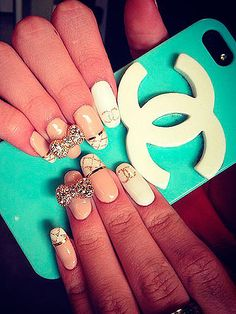 No, this isn't a new Chanel advert. It's Disney actress Bella Thorne's blinged up nail art. Wow, talk about a modern French manicure. While her nails looks very impressive, it wouldn't be too hard to copy as long as you have a steady hand. Want your own diamond bows? There's a great selection from retailers at Amazon.co.uk.  -Cosmopolitan.co.uk