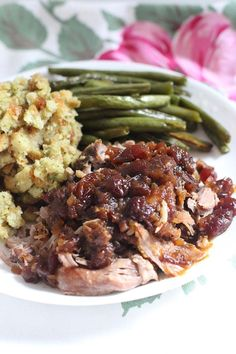 Slow Cooker Cranberry Pork Roast. Pork roast, can whole cranberry sauce, 1/4 cup honey, 1/4 cup dried minced onion. Serve w/ green beans & mashed potatoes (stuffing shown)