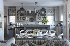 kitchens - Para Paints - Jetstream - Para Paints Shoreline Para Paints Herringbone Sarah Richardson Jake Stool Kravet Dotkat Mineral Kravet Sanabelle Driftwood Lantern - Of Things Past Chandelier Elegant Garage Sale light gray kitchen cabinets deep gray drop down kitchen cabinet kitchen island painted Para Paints Herringbone honed black granite countertops wine fridge