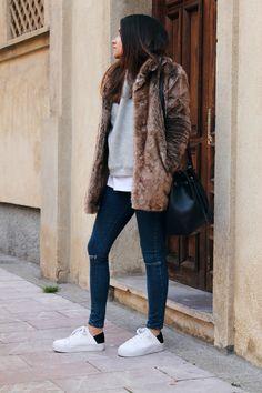 Fur coat, jeans and sneakers