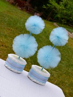 These light blue baby shower centerpieces are the icing on the cake...the diaper cake, that is! They are the perfect way to celebrate a new little princes arrival. Its the best of both worlds - an adorable decoration AND a practical gift for the mom-to-be! These Tulle Pompom Topiaries are made with a Diaper Cake base, making them the perfect baby shower centerpiece or decoration! These unique and adorable tulle pom pom topiaries come in many different colors! I do custom colors too! Sets…