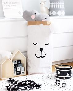 Kids room by projektvasastan. Scandinavian decor, Tellkiddo paper bag storage.