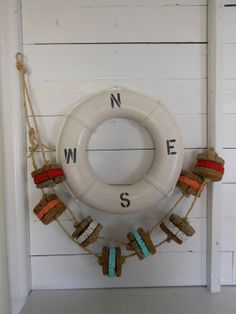 35 beach cottage decor for every room in your home 26 Fish Crafts, Beach Crafts, Vintage Beach Decor, Wall Groupings, Beach Cottage Decor, Beach Cottages, Nautical Theme, Ship Wheel, Lake Life