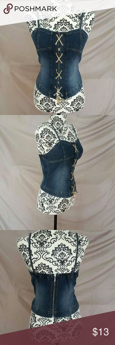 """Denim Corset Lace Up Top New without tags. Size Medium. The denim is pretty stretchy and features functional lacing up the front. Back zipper. The straps button in the back so you can wear them straight (shown) or crossed. Very cute top!  Measurements (laying flat, unstretched) Bust-15"""" Waist-15"""" Length-21.5"""" from top of straps to bottom No Boundaries Tops Tank Tops"""