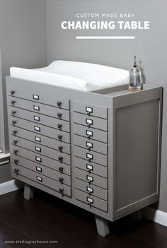 This baby changing table with lots of storage and even holds a diaper pail.