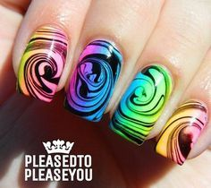 Another swirling marble nail art effect in neon colors against a black base polish.