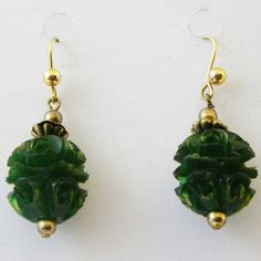 Dropper green unusual earrings with shaped carved bakelite inspired bead Victorian style earring in a green translucent color with ornate gold tone