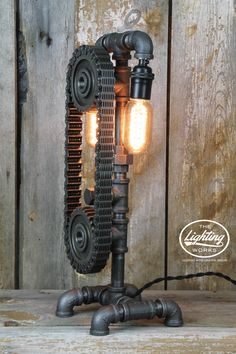 Steampunk Industrial Machine Age Lamp An excellent addition to the perfect man cave, this incredible industrial style table lamp is sure to make a statement in any room! Crafted from a variety of plum
