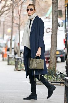Karlie Kloss wearing Stuart Weitzman Lowland Boots, Ayr the Robe Wool Coat in Nightshade and Balenciaga Papier A4 Mini Tote Bag in Vert Olive