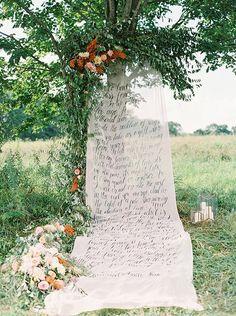 calligraphy wedding ceremony backdrop idea   image via: magnolia rouge