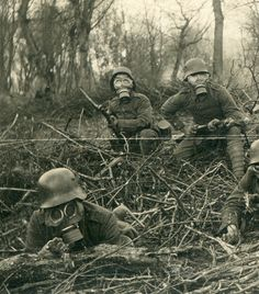 Detail, left side - A German Gruppen in respirators, with Kar98 rifles, creeping up on the camera. They are members of IR 167. The IR 167 saw action on the Eastern Front as well as the Western Front where they took part in the Spring Offensives of 1918.