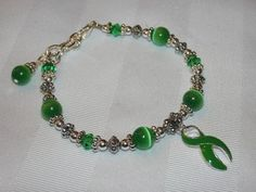 Green awareness bracelet with catseye and swarovski crystals!