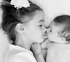 Eskimo Kisses  Capture the sweet moment of eskimo kisses between the two siblings