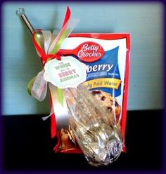"Peppermint Plum put together a little baking kit with a blueberry muffin mix and whisk. The tag says: ""We Whisk you a Berry Christmas!"" I love the puns and I especially love blueberry muffins!......plus more ideas☺"