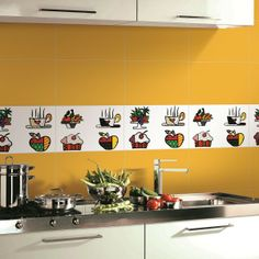 PAMESA BY BRITTO | KITCHEN | CERAMICKitchen featuring accent tiles from Parmesa by BRITTO Pamesa by BRITTO is an exclusive line of ceramic tiles featuring the vibrant and colorful illustrations of world renowned artist Romero Britto. BRITTO Kitchen available in 34 CM by 50 CM tiles. #ParmesaByBritto #Britto #MOTW