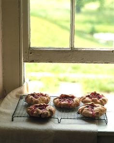 Individual Rhubarb and Raspberry Tartlets  The extra tablespoon of flour, sprinkled into the center of each pastry circle, helps thicken the rhubarb juices as the tartlets cook. -Martha Stewart