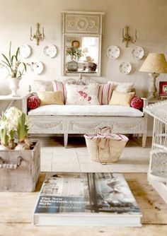 Beautiful French Country living room.  Love the accent colors!  Cream walls, cream tiles, white furniture.  Really like the softness.