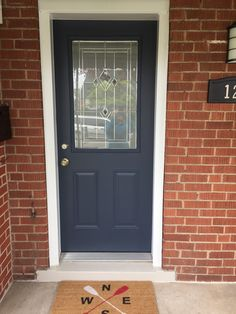 "Freshly painted front door...Benjamin Moore ""Hale Navy"" and ""Cosmopolitan"" for the step. Looking fantastic against the red brick."