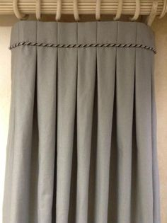 Accentuate #boxpleat #draperypanels with a #weltcord or twisted cord trim at the top for a unique look. This also draws the eye upward towards the #decorativehardware and intricate #headerstyle. #designtrends #windowtreatment #pleatedpanels