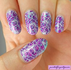 Painted Fingertips | Stamped flowers over a water marble