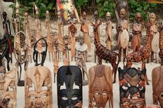 Wooden African handicrafts on the beach.