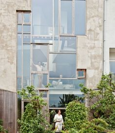 Joris Brouwers and Nicky Zwaan's Amsterdam home built constructed of concrete floors, clay walls, OSB staircase, window light and a plant jungle