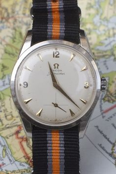 "Omega, ""Seamaster"" with Nato strap.  Who wants to buy it for me??"
