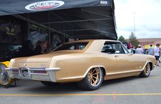 This incredible Builder's Choice award winning '65 Buick Riviera, by Mike Goldman Customs, is powered by a supercharged LSA and rides on an Art Morrison chassis, Strange 9-inch rear end, JRi coilovers, Baer brakes, Bridgestone tires, and Grip Equipped Dropkick wheels finished with custom gold centers & polished outers! See more: http://www.forgeline.com/customer_gallery_view.php?cvk=1703  #Forgeline #GripEquipped #Dropkick #notjustanotherprettywheel #madeinUSA #Buick #Riviera #GGPPGNationals
