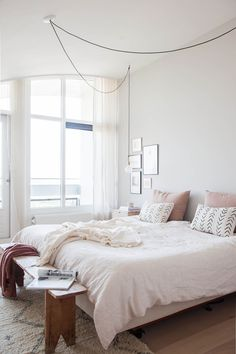 interior by holly marder. love the way the hanging lights go to both bedsides!