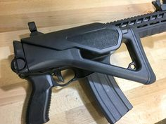 Sig Sauer 556xi Adaptive Tactical Carbine, It'll shoot with the stock folded and locked into place.