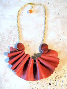 Ruffled Tan Leather Bib Necklace on Gold Chain. $28.00, via Etsy.