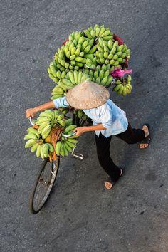 vendor pushing bicycle with bananas - Viet Nam