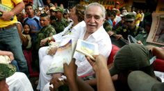 """Admirers ask Gabriel Garcia Marquez --€"""" seated alongside his wife, Mercedes Barcha €-- to sign books in Santa Marta, Colombia, in 2007."""