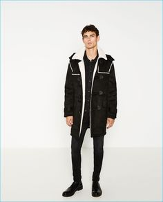"Arthur Gosse dons a black ""shearling"" duffle coat from Zara Man."