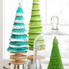 Cupcake-liner trees - http://www.bhg.com/christmas/crafts/christmas-holiday-crafts/?page=4&ordersrc=rdbhg1107727#page=6