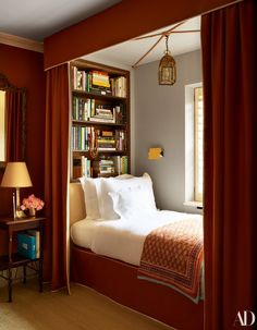 See Inside Nina Flohr's Glamorous Yet Cozy London Townhouse – In a guest room, bed and canopy designed by Veere Grenney Assoc. Flohr picked up the blanket in India. - See Inside Nina Flohr's Glamorous Yet Cozy London Townhouse - In a guest room, . Home Design, Design Ideas, Home Library Design, Studio Design, Library Ideas, Diy Design, London Townhouse, Canopy Design, Interior Design Small Bedroom