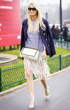 Kate Davidson Hudson with a navy blazer draped over the shoulder, striped t-shirt, and strappy heels
