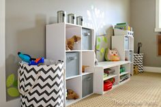 Playroom Makeover ~ cube storage and craft paper accents with chevron storage bins ~ www.theuniquenest.com