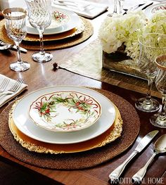 The family enjoys Christmas dinner served on Tiffany holiday dishes combined with family china.