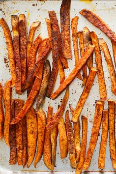 "These addictive seasoned ""fries"" from Mark Bittman are actually baked, but we promise you won't miss the grease. The spice mix – garlic powder, paprika, salt and black pepper – can be used on regular potatoes as well (you'll just need to increase the baking time a bit). (Craig Lee for The New York Times)"