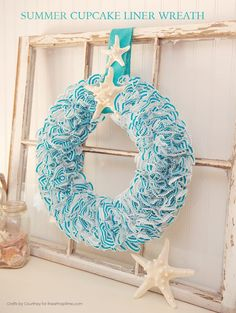 Create a fun Summer Wreath using cupcake liners!! It's so easy and looks perfect for any Summer decor. I added a couple seashells to finish off with a coastal look.
