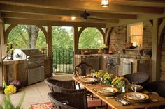 Great Outdoor Kitchen Design in this covered patio. Nice dining space and all. Love! #outdoorliving