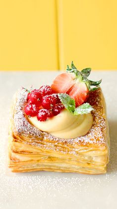 Crispy pastry cups filled with gorgeous vanilla bean cream topped with berries.